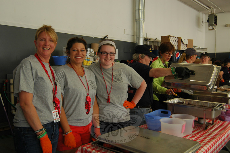 From left, Christine O'Grady, Debbie Aurelia Halstead, and Danielle Spinelli were at the ready to serve at the first evening of the 27th Annual Sandy Hook LobsterFest, Friday, June 6. (Hallabeck photo)