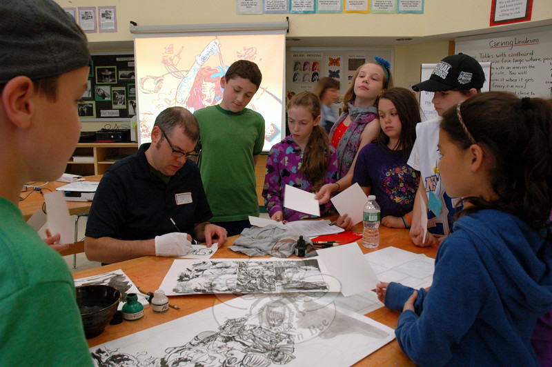 Nathan Fox was surrounded by students as he demonstrated his drawing techniques at Reed Intermediate School on Friday, June 6.