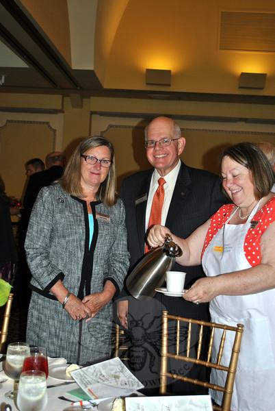 Peg Velthuzian, right, corporate sponsor Union Savings Bank hostess, serves coffee to bank President Cindy Merkle, left, and Fran Dattalo, CEO. (Crevier photo)