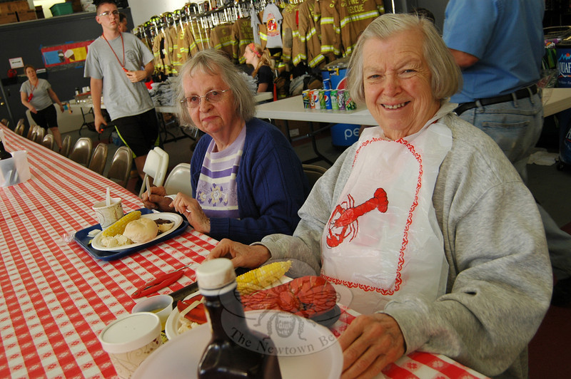 Connie Koskelowski, right, and Louise Burr were two of the first people to grab dinner and sit down for their meal on Friday, June 6, the first evening of this year's Sandy Hook LobsterFest. (Hallabeck photo)