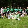 Sandy Hook Sole Sisters team members and supporters standing, from left, are Pamela Fehrs, Kim Bepko, Jennifer Krucker, Barbara Sibley, Joanne Kenny, Aimee Tabor, Desiree Vaiuso, Marlena Young, Natalie Young, Kathleen Young, and Lauren Young. The children with the dogs are, from left, Ellie Bepko, Brian Sibley, Lily Wasilnak, Jason Wasilnak, and Kyle Tabor. The dogs are Bella, Nayla, another Bella, Toby, Wiley, Max, and Dillon. Another SHSS who was at the event, but not in the photo was Annie Haddad, who was working giveaway table. (Gorosko photo)