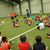 The Newtown Junior Women's Club hosted a capture the flag event at NYA Sports & Fitness Center on Sunday, June 8. Newtown High School guidance counselor Jeff Tolson, standing center, introduced attending students to the event before explaining two games of capture the flag would be played, one for kindergarten through third graders and one for fifth grade to eighth graders, during the event. (Hallabeck photo)