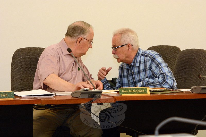 Planning and Zoning Commission (P&Z) Chairman Robert Mulholland, left, confers with P&Z member Donald Mitchell at a June 5 session at which the P&Z approved new zoning regulations that greatly increase the proportion of apartment housing that may be constructed at new commercial buildings in B-1 and B-2 (Business) zones. (Gorosko photo)