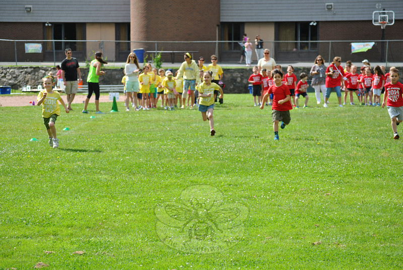 Kindergartners from Ms Dievert's and Ms Kuligowski's classes dart forward during the 50-yard dash. (Crevier photo)