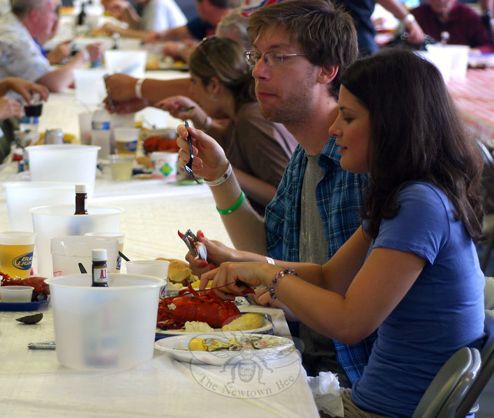 The 27th Annual Sandy Hook Lobsterfest was held on Friday, June 6, and Saturday, June 7. A total of 1,800 lobsters and more than 600 pounds of steak were served last weekend, according to LobsterFest Committee Chairman Anthony Capozziello. Guests also had the chance to purchase tickets each night, taking a chance on one of two 10-pound lobsters that were raffled. In addition, the company added a raffle of goods and services this year. Attendees could take their chance on more than 30 items and gift certificates that had been donated by local businesses. Proceeds from the event benefit the volunteer fire company, one of five that respond to Newtown's homes, businesses and roadways during emergencies. (Hicks photo)