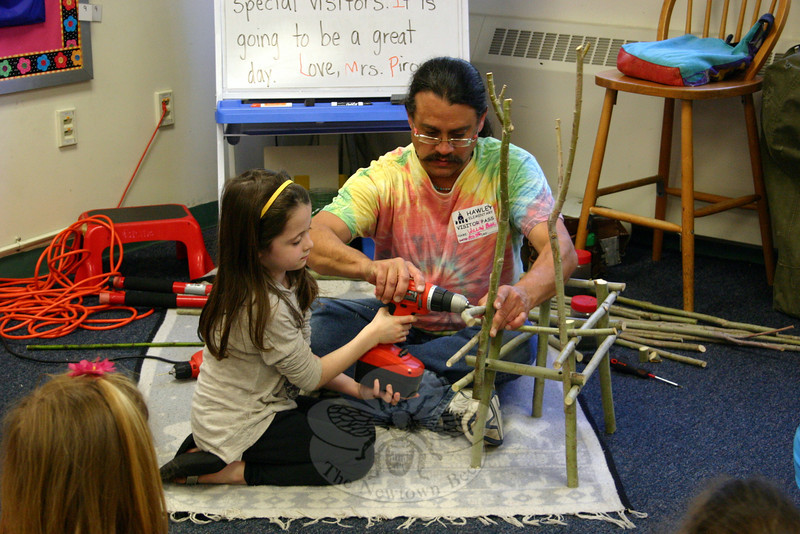 Under the guidance of Willow Bill, Hawley School student Cydney Turoczi operates a hand drill to connect two pieces of willow. Willow Bill made sure every student in the eight classes he visited last month had the opportunity to participate in the project. (Hicks photo)