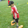 "Brandon Wong worked to walk using ""Monster Trax"" at one station for Sandy Hook School's Field Day. (Hallabeck photo)"