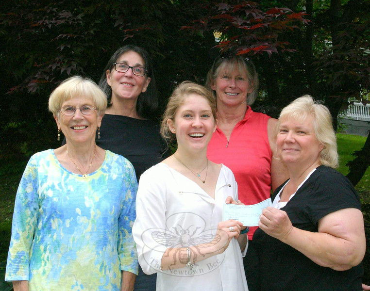 The Scholarship Committee of Newtown Visiting Nurse Association recently presented three scholarship checks to students who have met requirements for their respective honors. On June 5, members of the committee presented the final $4,000 Anna E. Clow Scholar-ship check to Abigail Blakeman, center. Abigail has just completed her sophomore year at the University of Connecticut School of Nursing. She is a 2012 Newtown High School graduate. The Anna E. Clow Scholarship is one of three awarded annually by the local Visiting Nurse Association chapter to students entering a nursing program awarding an RN or BSN degree. The scholarship money is awarded when the student begins clinicals, usually the end of the second or beginning of the third year in school. In the future, the Clow scholar-ship will be referred to as The Newtown VNA Scholarship. Joining Abigail for the check presentation were, from left, Margareta Kotch, VNA Scholarship Committee member; Alice Falkowitz, treasurer; Deb Osborne, co-president; and Anna Wiedemann, chair of the Scholarship Committee.  (Hicks photo)