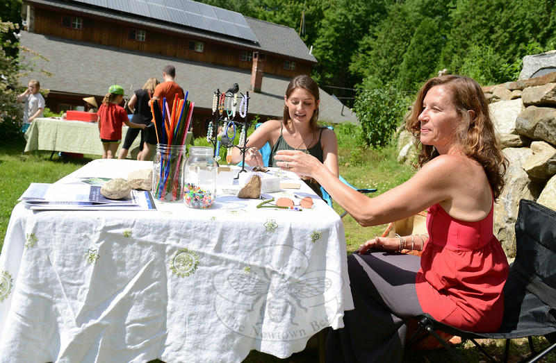 Sheryl Fatse, right, and her daughter Rachel make crafts and offer information on the Yoginilini workshops, which are a series of yoga instruction for young adults.  (Bobowick photo)