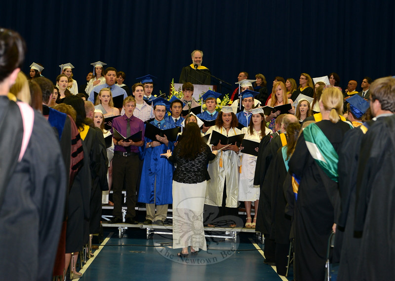 "The high school Chamber Choir sang ""The Star-Spangled Banner"" as the ceremony began. At top, center, is Interim Principal Jeffrey Jaslow. (Bobowick photo)<br /> <br /> Additional photos from NHS graduation are also available in a separate gallery:<br /> <a href=""http://photos.newtownbee.com/Special-Events/NHS-Class-of-2014-Graduation/"">http://photos.newtownbee.com/Special-Events/NHS-Class-of-2014-Graduation/</a>"
