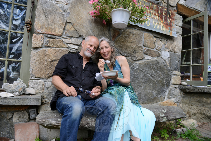 Sandy Hook residents Rick and Cynthia Quintanal enjoy a cool snack Saturday afternoon.  (Bobowick photo)