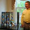 Don Droppo, Sr, retired owner of Curtis Packaging Co. in Sandy Hook, stands next to the sculpture he commissioned from artist Lucy Lyon, following 12/14. The glass and cast glass sculpture will be available for public viewing weekdays through the end of July. A public reception is scheduled for Sunday, June 29.  (Crevier photo)