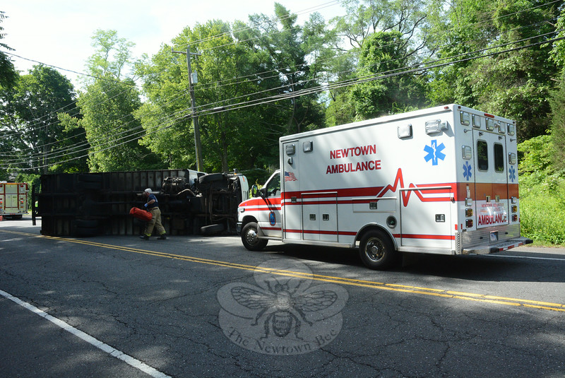 A two-vehicle accident, in which a large box truck rolled over onto its side on Berkshire Road (Route 34) near its intersection with Gray's Plain Road and Bennett's Bridge Road at about 9:40 am on June 16, caused extended travel delays and detours in that area. Police, Sandy Hook Volunteer Fire & Rescue Company members, and the Newtown Volunteer Ambulance Corps responded to the incident. Police said motorist Alexa Larsen, 46, of 123 Lakeview Terrace, who was driving a 2009 Honda Accord coupe, stopped at a stop sign at the end of Gray's Plain Road, as trucker Steven Goodman, 56, of Ridgefield was driving a 2008 UD box truck westward on Berkshire Road. The Honda then entered the intersection, resulting in the two-vehicle collision, police said. The truck went out of control and then landed on its left side on the roadway. Goodman was treated for injuries, police said. Larsen received an infraction for failure to grant the right of way at a stop sign, according to police.  (Gorosko photo)