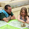 Lee Swanson, left, and his daughter Kaelyn enjoy building sandcastles in the Ben's Bells and EverWonder activity room at the Middle Gate Madness event, Friday, May 23. (McHugh photo)