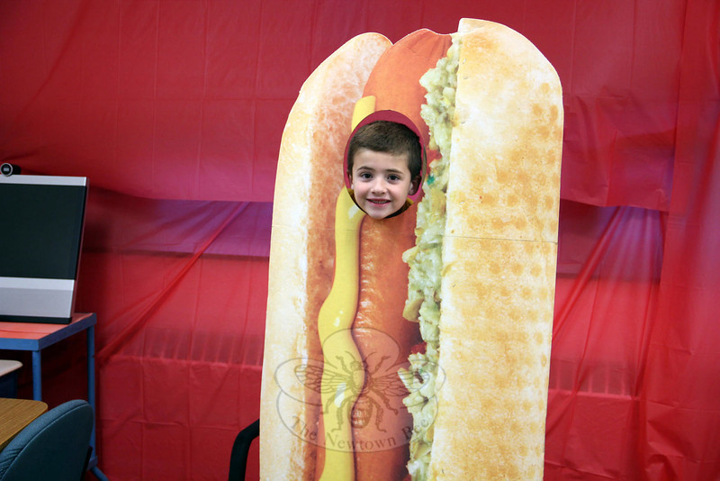 Jake Mottola poses as a hot dog in the Photo Room, one of the many activities offered during Middle Gate Madness. (McHugh photo)