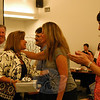 Hawley Elementary School Principal Jo-Ann Peters-Edmondson, center left, was among the 15 retiring educators honored during Tuesday's Board of Education meeting. BOE Secretary Kathy Hamilton, second from right, offered Ms Edmondson a hug. (Hallabeck photo)