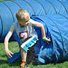 Brett Palmer scrambles out of the tunnel set up on the obstacle course. (Crevier photo)