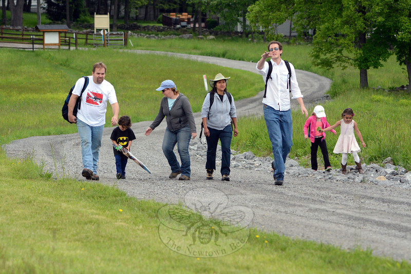 A group of seven hikers led by Dr Aaron Coopersmith, third from right, climbed a curving path on Holcombe Hill to get to the summit where they flew kites on Saturday, May 31. The cleared summit catches wind from all directions, making it a favorite place to fly kites. (Gorosko photo)
