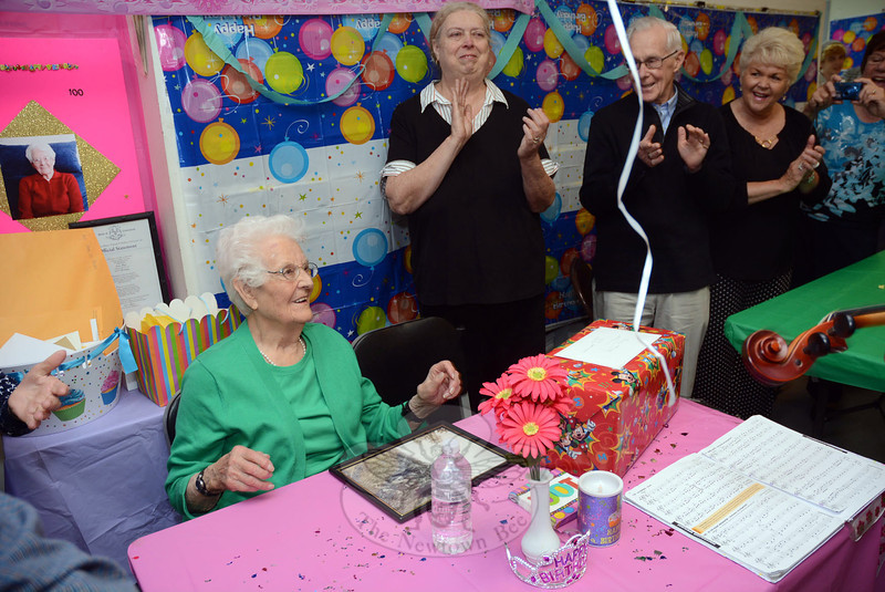 Anna Bresson Maye, seated at left, was honored at her heavily attended 100th birthday party held on Saturday, May 31, in the Botsford Post office at 1 Botsford Hill Road. Ms Maye turned 100 on June 1. Ms Maye is a former Botsford postmaster, having run mail operations for that section of town for many years. Standing immediately to the right of Ms Maye is current Botsford Postmaster Nancy Kuszpa, who helped organize the party. The centenarian and her many friends and associates reminisced at the party, which filled the post office with well-wishers. (Gorosko photo)