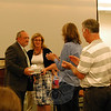 The Board of Education honored both retiring educators and students who earned grade point averages within the top five percent of Newtown High School's Class of 2014 graduating class during its Tuesday, June 3, meeting. (Hallabeck photo)