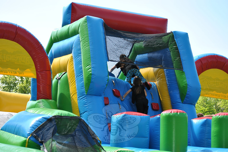 Students take on the inflatable obstacle course during the Hawley Elementary School Field Day, Friday, May 30. (Crevier photo)