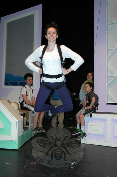 """Newtown High School junior Victoria Madden was strapped in and practicing her """"flying"""" techniques on Monday, March 10. Victoria is set to play the lead role of Peter Pan in the school's upcoming musical production. (Hallabeck photo)"""