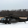 Although helicopters don't often travel to Newtown, one arrived on the morning of Wednesday, March 12, carrying several soldiers who went to the Connecticut Army National Guard's military dog kennel at Fairfield Hills for a meeting. The US Army's 65-foot-long Sikorsky Black Hawk helicopter sat parked in a snowy farm field near the kennel while the military personnel toured the facility. The kennel opened in the spring of 2006 for the training and keeping of military dogs. The $2.5 -million kennel is used by the guard for its antiterrorism work. The army called Newtown Hook & Ladder volunteer firefighters to the kennel for the aircraft's arrival and departure as a safety measure. (Gorosko photo)