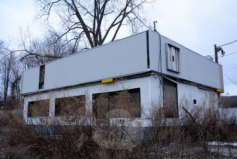 This vacant decaying commercial building, which formerly held a Shell gas station/convenience store, stands on a one-acre site at 67 Church Hill Road. The Planning and Zoning Commission is scheduled to discuss and possibly act on the redevelopment of that site at a March 20 public hearing. (Gorosko photo)