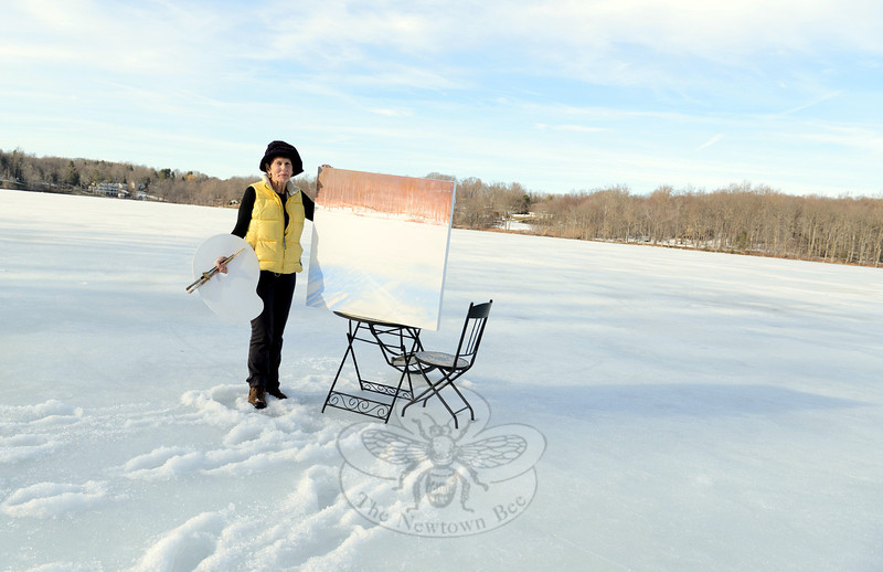 Mimicking natural colors of the shoreline across an icy Taunton Lake, Patricia Barkman committed to canvas the scene she sees opposite her lakeside home. (Bobowick photo)