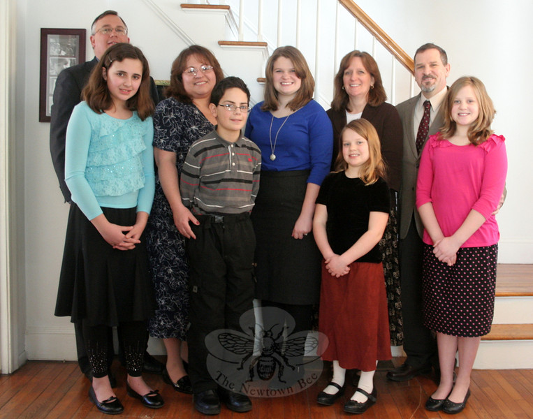 Sandy Hook Baptist Church is temporarily meeting out of a residence in Sandy Hook, but hopes to move into a more central location within a few months. Until then the church's services and bible studies will continue to be hosted by Paul and Ana Schriever and their family. Pastor Chris Camp, second from right, is the spiritual leader of the recently formed church. From left, back row, are Mr and Mrs Schriever, Olivia Camp, and Jayne Camp; in front, Sophia and Paul Christopher Schriever, and Grace and Sarah Camp. (Hicks photo)
