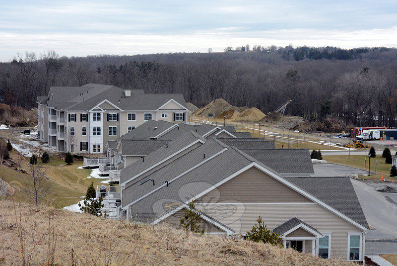 From an overlook at the Newtown Woods site in Hawleyville, the roofs of a row of smaller townhouse-style buildings in the foreground frames a large apartment-style condominium building in the back-ground. The planned 178-unit age-restricted project is the largest complex of its type to be built locally since the 189-unit Walnut Tree Village, which started construction in the mid-1990s. (Gorosko photo)
