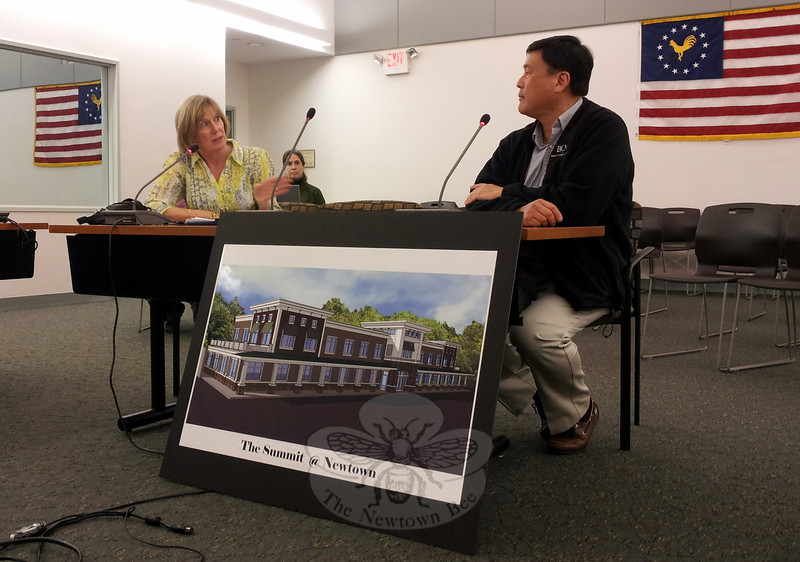 Elizabeth Stocker, Newtown's director of economic and community development makes a point during a March 17 Board of Selectmen meeting, regarding a Business Incentive Plan application from devel-oper John Reyes. Mr Reyes, seated right, is developing The Summit @ Newtown as a mixed commercial/retail center at 146 South Main Street. He received approval for a partial three-year abatement of property taxes once the project is complete and assessed. (Voket photo)