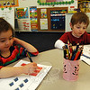 The Learning Experience (TLE) in Newtown owner Danielle Van Riper said traditional activities, like drawing and counting in a workbook, will be included in the next generation of TLE's curriculum, which will also include new interactive screens with touch technology. Logan Ausderon, right, and Clare Csaszar worked in their workbooks on Wednesday, March 5. (Hallabeck photo)