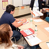Brookfield-based technology consultant Dawn DeCosta used a box of donuts to illustrate the dozen or more ways children can access and reveal themselves — and oftentimes, private or personal in-formation about themselves — when they use Internet and social networking sites to socialize. (Voket photo)