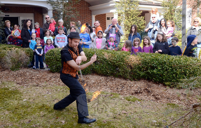 Juggler and entertainer Eric Girardi helped teach a group of youngsters how to juggle, and thrilled attendees with a program of fire juggling that ended with a fire eating demonstration during grand reopening festivities March 22 at the C.H. Booth Library. Later in the day parents were invited to attend an a separate musical program with singer and songwriter Lenny Levine (not pictured). (Voket photo)