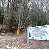 A large sign on the east side of Pole Bridge Road marks the beginning of a trail that leads through the open space preserve. Four pieces of property have been combined to make up the 50-plus-acre preserve in Sandy Hook. Following recent meadow clearing and invasives removal, Newtown Conservation Commission members have published a brochure that offers background about the property as well as a trails map. (Bobowick photo)