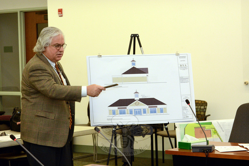 At a March 20 Planning and Zoning Commission (P&Z) public hearing, architect Hugh Sullivan described aspects of a gas station/convenience store planned for 67 Church Hill Road. At the meeting, P&Z members approved the construction plans and also liberalized the zoning regulations that cover such facilities. (Gorosko)