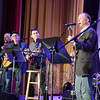 Guest artist and Newtown resident Mark Barden, right, performed with the Flagpole Radio Café on Saturday, March 22. Joining him on the Edmond Town Hall Theater stage are members of the Flagpole Radio Café Orchestra, from left, Howie Bujese, Dick Neal, and Jim Allyn. (Bobowick photo)