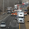 As viewed from the Church Hill Road overpass above eastbound Interstate 84, various emergency vehicles were grouped around an accident that involved a tractor-trailer truck and two autos at about 9:37 am on Friday, March 21. The incident caused extensive travel delays on the highway. (Gorosko photo)