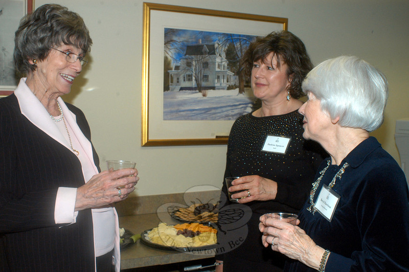 From left, Ellen Parrella, library staffer Darlene Spencer, and Acting Director Beryl Harrison enjoyed socializing and showing off the spruced up C.H. Booth Library during a special grand reopening by invitation reception March 21. (Hutchison photo)
