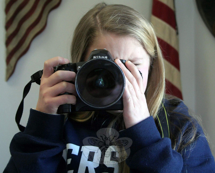 "With two first place awards to her credit already, Katie Sailer is getting very comfortable behind a still camera. Katie, 13, won first place in The Len Freas Youth Division in Wilton Art Council's 16th annual photography exhibition with her work, called ""Effervescence."" (Hicks photo)"