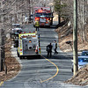 Looking northward on High Rock Road from a point near its intersection with Kelly Court, fire vehicles from Botsford and Sandy Hook were positioned on the road as firefighters worked to put out multiple brush fires.  (Gorosko photo)