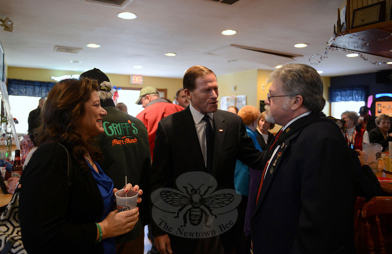Town Clerk Debbie Aurelia Halstead speaks with Senator Richard Blumenthal, center, and VFW post 308 member Jay Gill. (Bobowick photo)