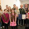 On Monday afternoon, First Selectman Pat Llodra officially proclaimed March 12 to be Girl Scout Day in Newtown. Girl Scout Week will be observed across the country March 9–15. Joining the first selectman for the reading of her official proclamation on March 3 were, front row from left, Brownie Scouts Addison Lewis, Skylar Lewis, and Lauren Smiley; center row, Cadet Scouts Rose Wheway, Katherine Trammel, Becca Remsen, and Annaleigh Davidow; and rear, Cadet Rachel Wolf, Ambassador Mary Kate Holmose, and Senior Girl Scouts Amy Pruner and Sarah Bender. (Hicks photo)