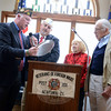 Right, Mae and Bob Schmidle share a plaque to the VFW post from their son Robert, a lieutenant general in the Marines. Reading its inscription are Vice Commander Brendan Dlouhy, left, and Commander James Rebman. (Bobowick photo)