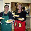 "Kym Venezia and Melanie Mattegat prepare to deliver meals during Tuesday's event at St John's Church. A small but hardworking crew kept the event moving very smoothly this year, sending a few dozen people home happily fed on Shrove Tuesday. St John's Warden Bruce Moulthrop said he also received ""some 11th hour help"" from Blue Colony Diner this week. The Church Hill Road eatery donated creamers to the church when it was learned that organizers were having trouble finding them for the pancake supper. (Hicks photo)"