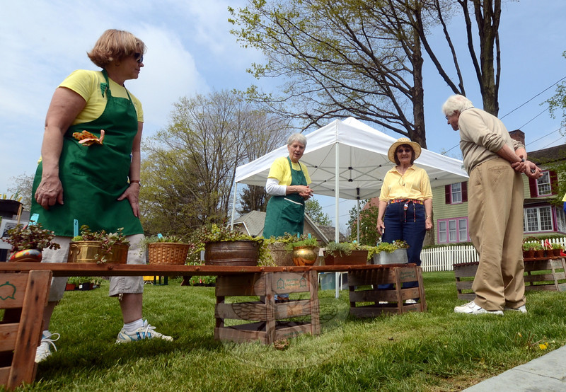 The Town and Country Garden Club of Newtown held its annual plant and flower sale at The Inn at Newtown Saturday, May 10. Volunteers mixed with interested supporters, many of whom walked away with arms or wagons full of hand tended flora for their own properties. Among the attendees were Stanley and Carole Polcyn, at right, talking with club volunteers Barbara McCann, far left, and Carol Smiley. (Voket photo)