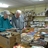 Volunteers at C.H. Booth Library on Sunday, May 4, from left, Carm O'Neill, Charles Hogan, and Jane Gatenby, sorted books that were dropped off for Spring Book Donation Day, when donations of books, CDs, DVD, LPs, games, puzzles, and computer games are sought for the annual Friends of Booth Library Book Sale. Volunteers accepted the books from people who dropped them off, and sorted them.  (Hallabeck photo)