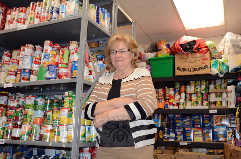 Dozens of volunteers, including the mother-daughter team of Pam and Alexandria Tassiello, and the tremendous outpouring of donations from residents helped make this year's Postal Food Drive a monumental success according to Newtown Social Services Staffers Ann Piccini and Ann Benore. Ms Piccini (pictured) said Wednesday that more than 100 recycling bins brimming with nonperishable items took three days to sort and shelve, providing a surplus that is expected to get local families in need through the summer months. Volunteers also noted that very few outdated or expired items found their way into the system this year. (Voket photo)