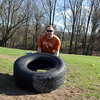 Antonio Gallucci demonstrates using a large tire as part of a fitness routine, including the special boot camp classes being offered through the end of June as a fundraiser for a Hawley School teacher. (Bobowick photo)